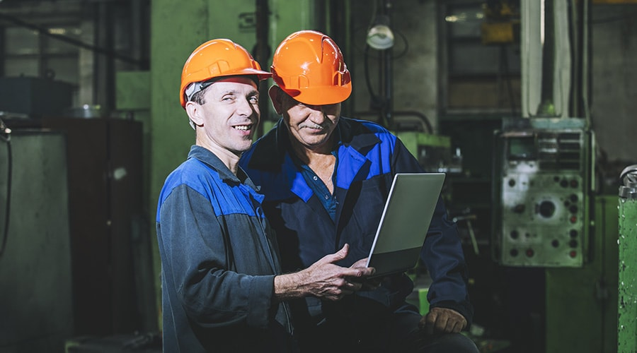 Two application engineers on a factory floor