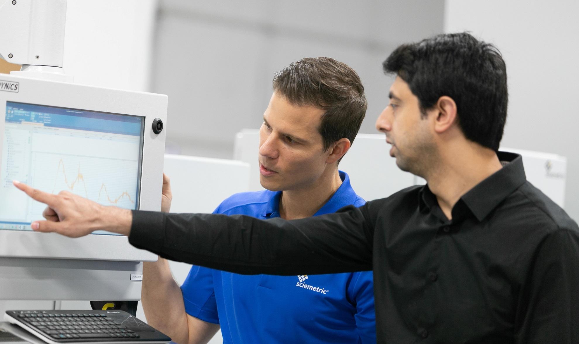Sciemetric staff reviewing process data on screen
