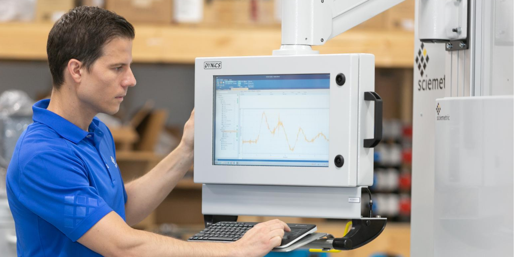 Sciemetric staff on production floor looking at data