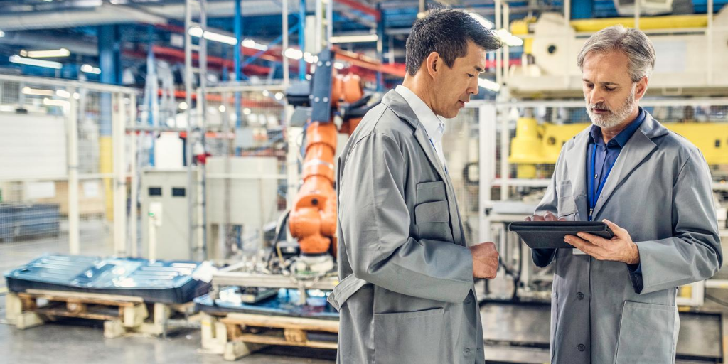 Two men in discussion on production line floor